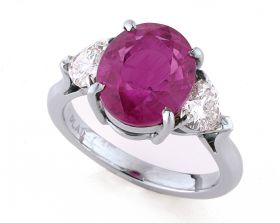 Cushion Pink Sapphire 5.57ct (H) set in platinum with Heart Shape diamonds