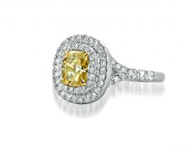 Cushion 0.87ct Fancy Intense Yellow (GIA) setin platinum & 18Y with a pave double halo & pave split shank