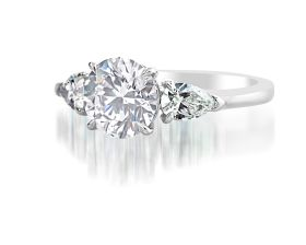 Round 1.54ct I VS2 (GIA), set in Platinum with Pear Shapes